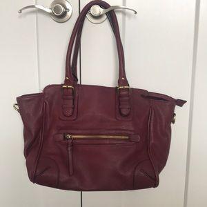 ALSO maroon handbag- minor interior staining